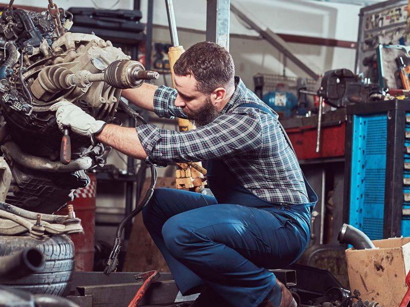 brutal-tattooed-mechanic-repairs-the-car-engine-in-small.jpg