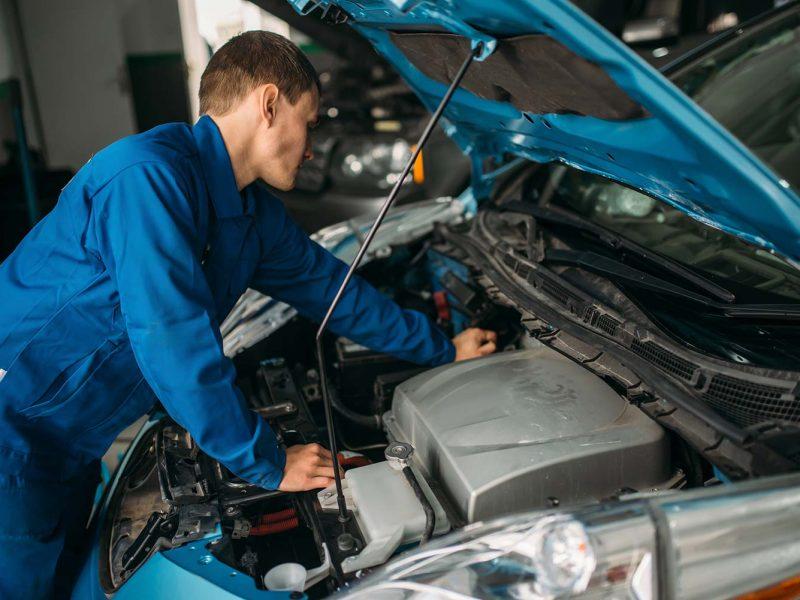 mechanic-repairs-car-engine-motor-diagnostic-small.jpg